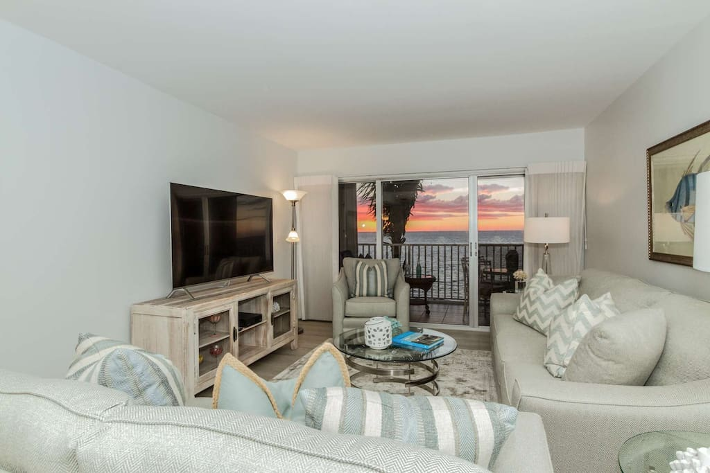 Vacation in the luxury of this renovated coastal inspired 8th floor condo with incredible views from your living room.