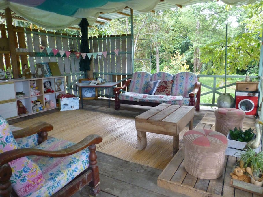 The upstairs open lounge overlooking the garden and forest