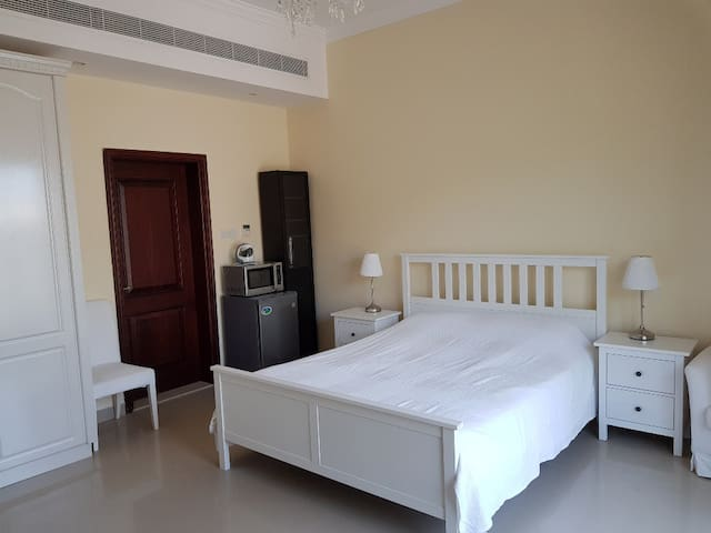 Fully furnished room in a very spacious villa
