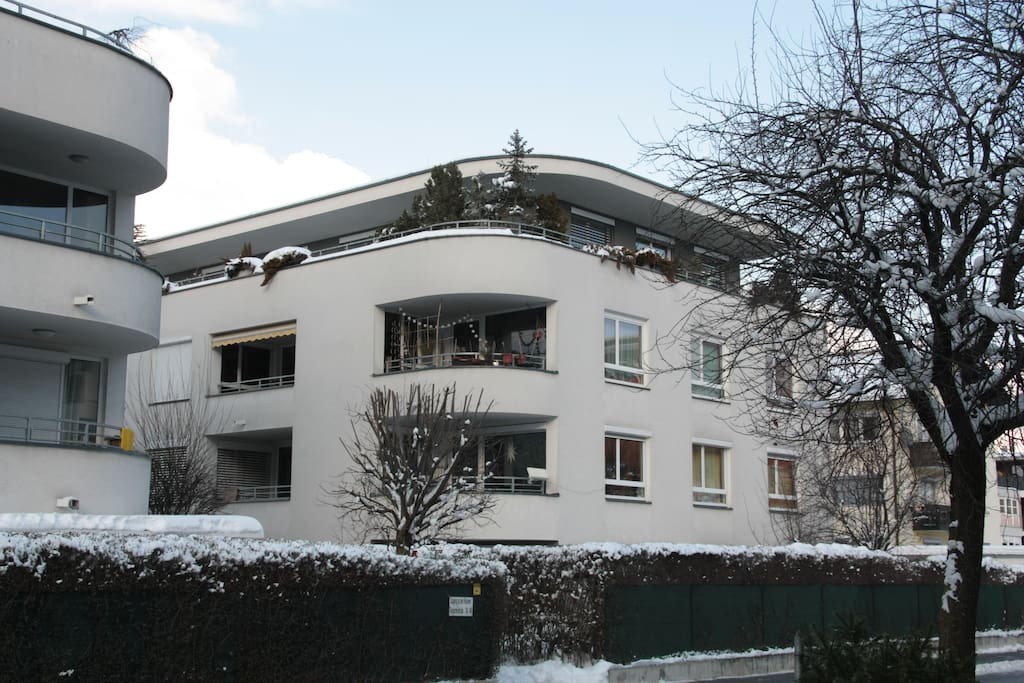 House from the outside in the winter. The apartment is on the 2nd floor.