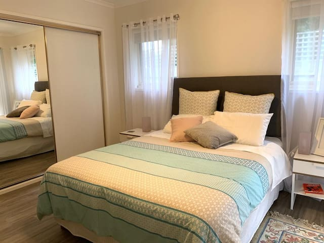 Bright Airy bedroom with queen size bed, windows facing back garden.  TV in room