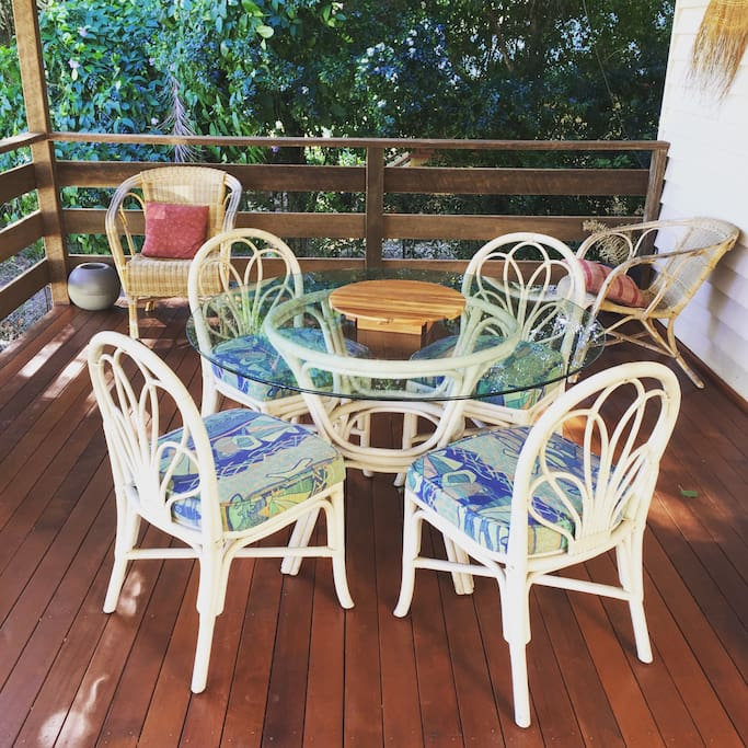 Comfortable front deck which overlooks the park across the road