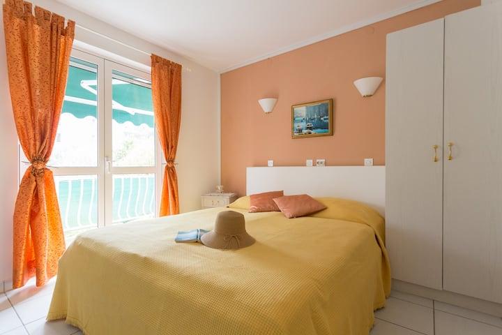 Sunny apartment with balcony near the beach.