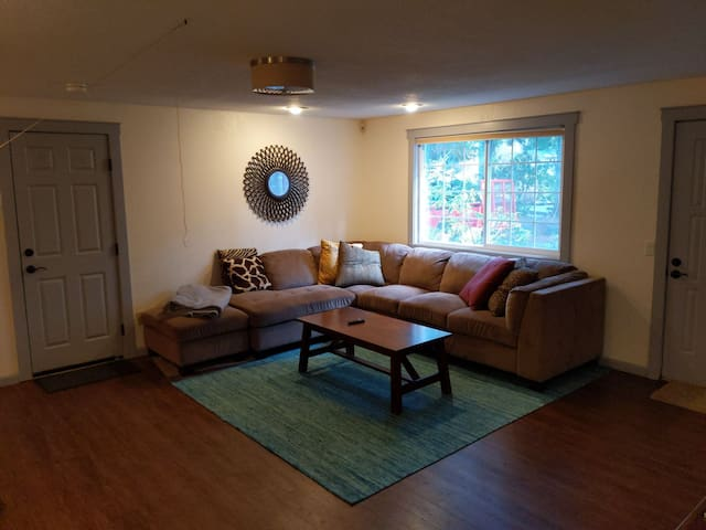 Bedroom on the golf course w/ large sectional/tv