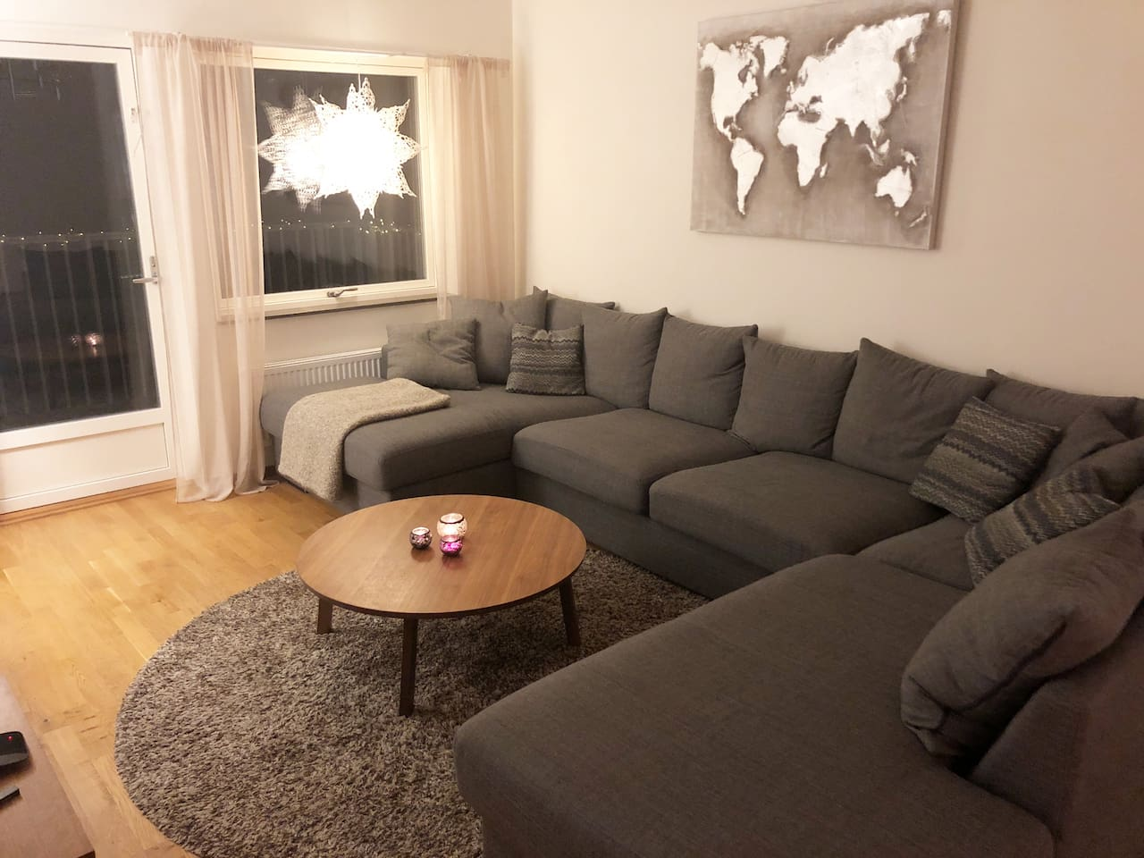 Livingroom with large sofa and tv