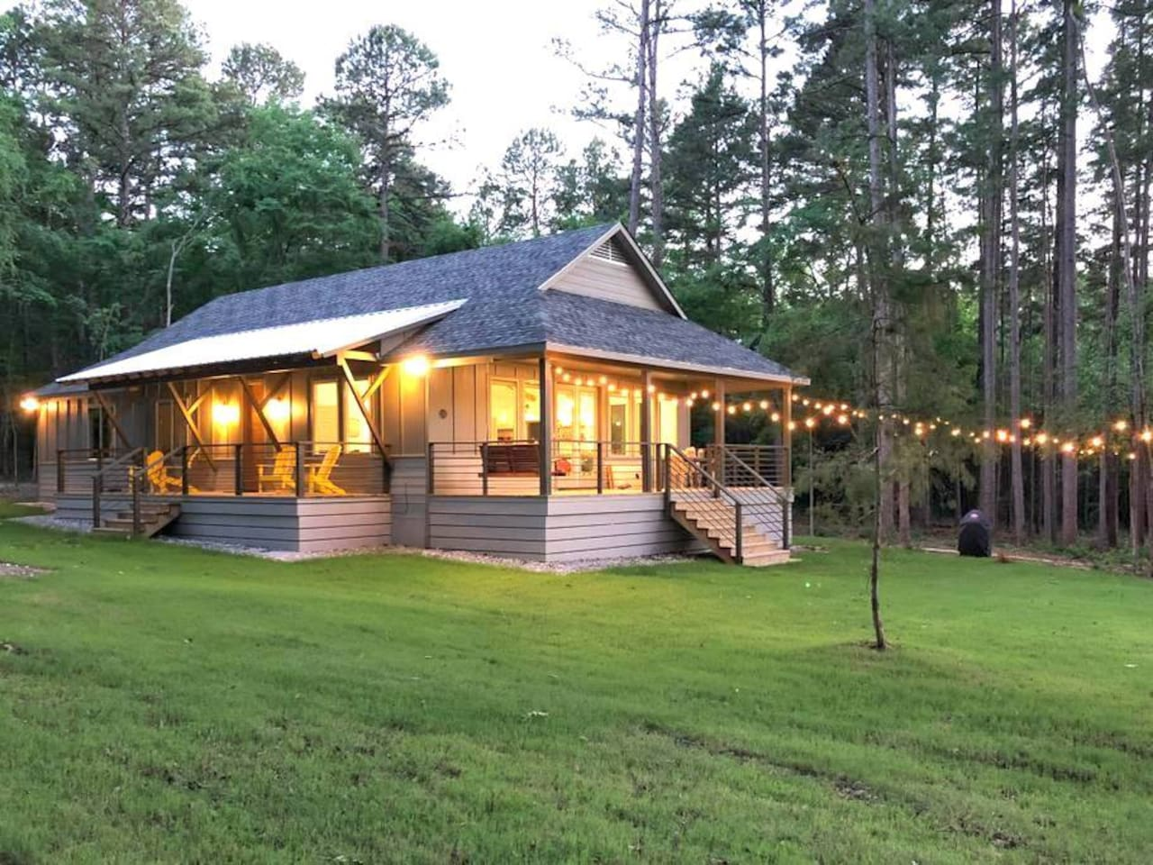 Two covered porches, plenty of outdoor lighting, and a great lawn to play on