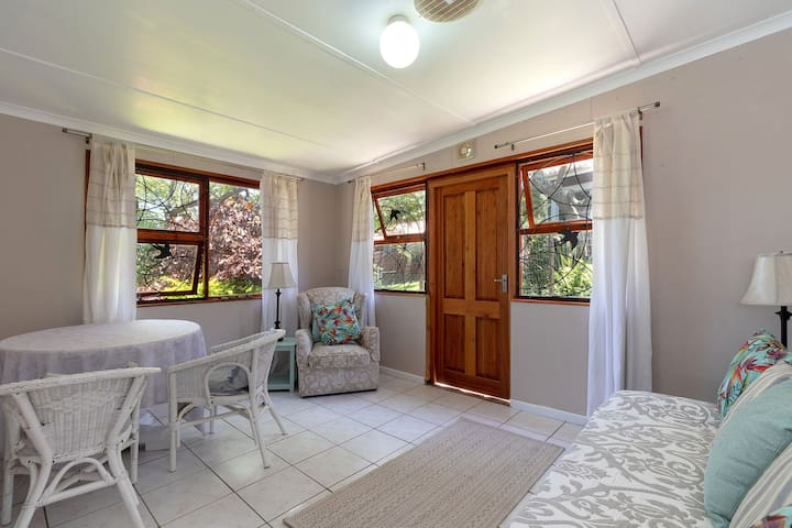 Sitting room with comfortable couch which can become a very comfortable sleeper couch for one or two children. Beautiful outlook on to garden.