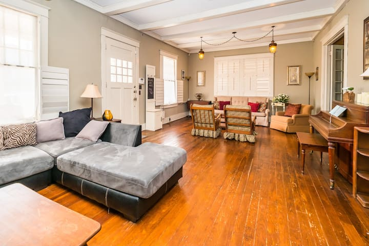 Great Room with piano. This room has a sectional and another couch, both which sleep really comfortably. The sectional can sleep two small people and the couch can sleep one person. Neither couch pulls out.