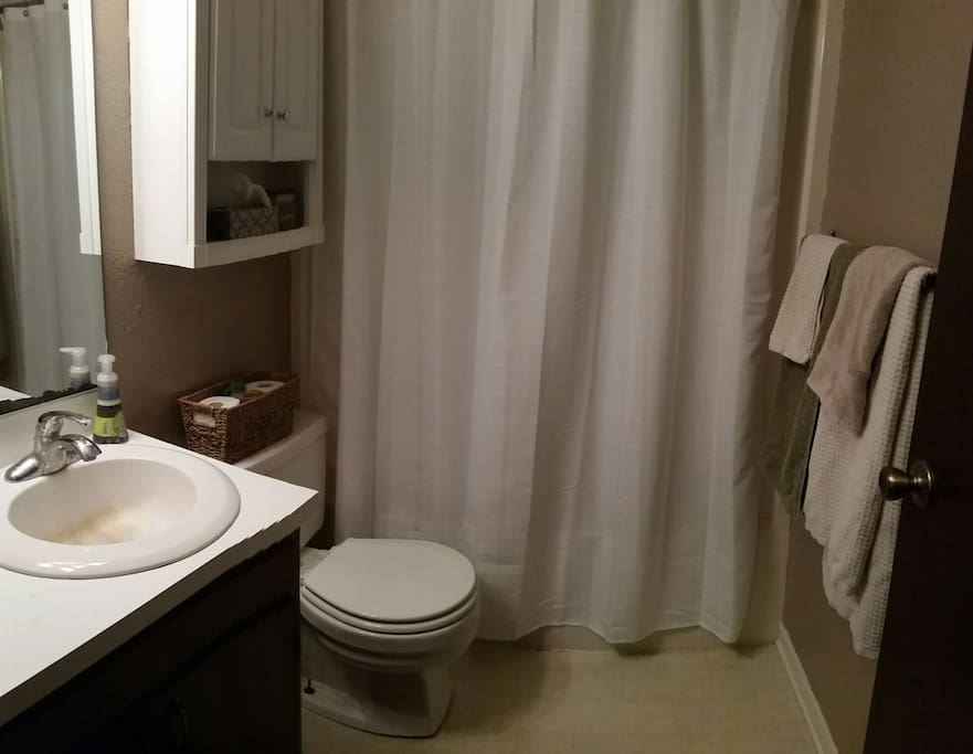 Guest bathroom with fresh linens.