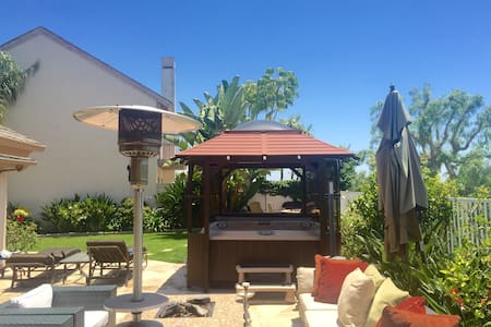View, Private backyard with hot tub and firepits
