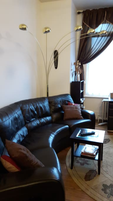 Oval shaped leather couch with 2 comfy Recliners plus 3 stage lighting