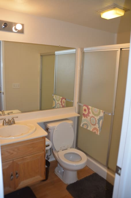 Your private bathroom just outside your bedroom door.