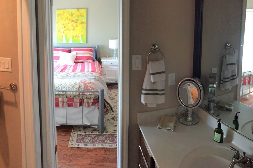 Connecting private bathroom. View into main bedroom.