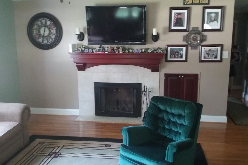 Living Room with Flat screen TV and fireplace