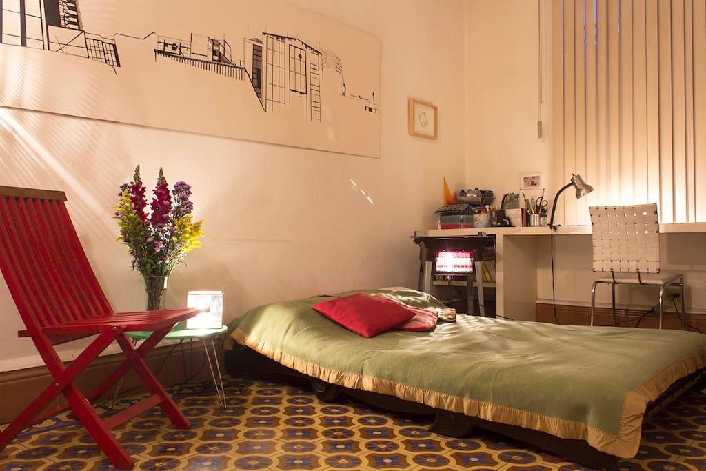 Sala con futón cómodo y fácil de armar-desarmar.