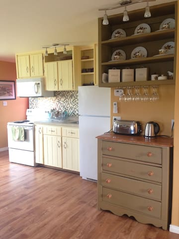 Country style kitchen open to living area.