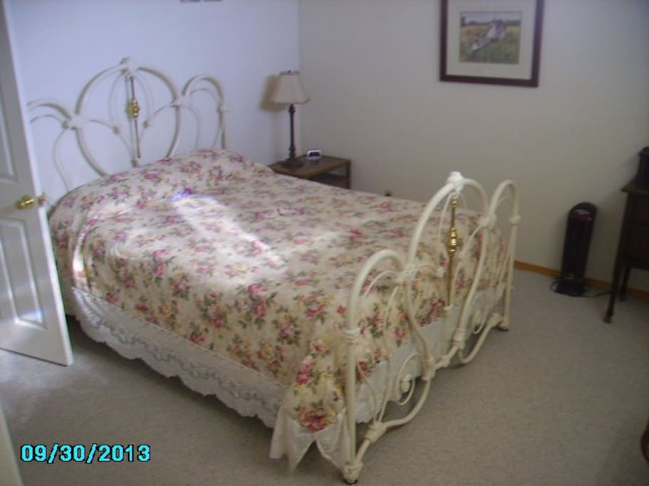 Queen bed in the lower level.