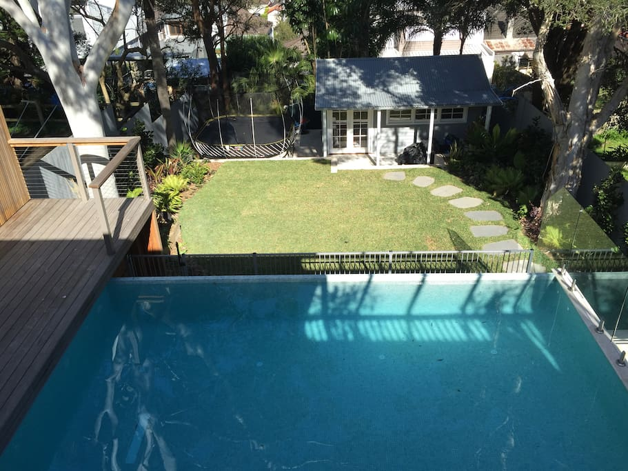 Pool, sun deck and trampoline