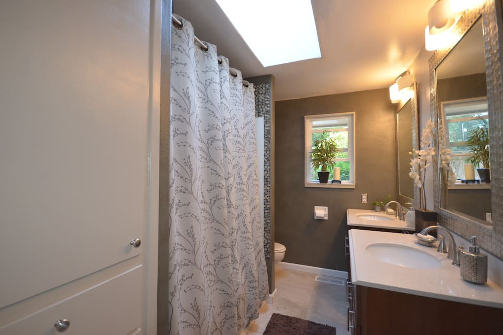 Shared Full bath with dual vanities and sinks.