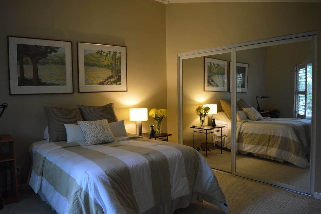 master bedroom with private bath; large mirrored closet space