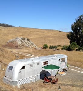 This listing is a classic Spartan, a top of the line 1951 house trailer, now restored and made comfortable for you. The Spartan is sited on three quarters of an acre on the Field of Dreams, several miles east of Tomales, CA.