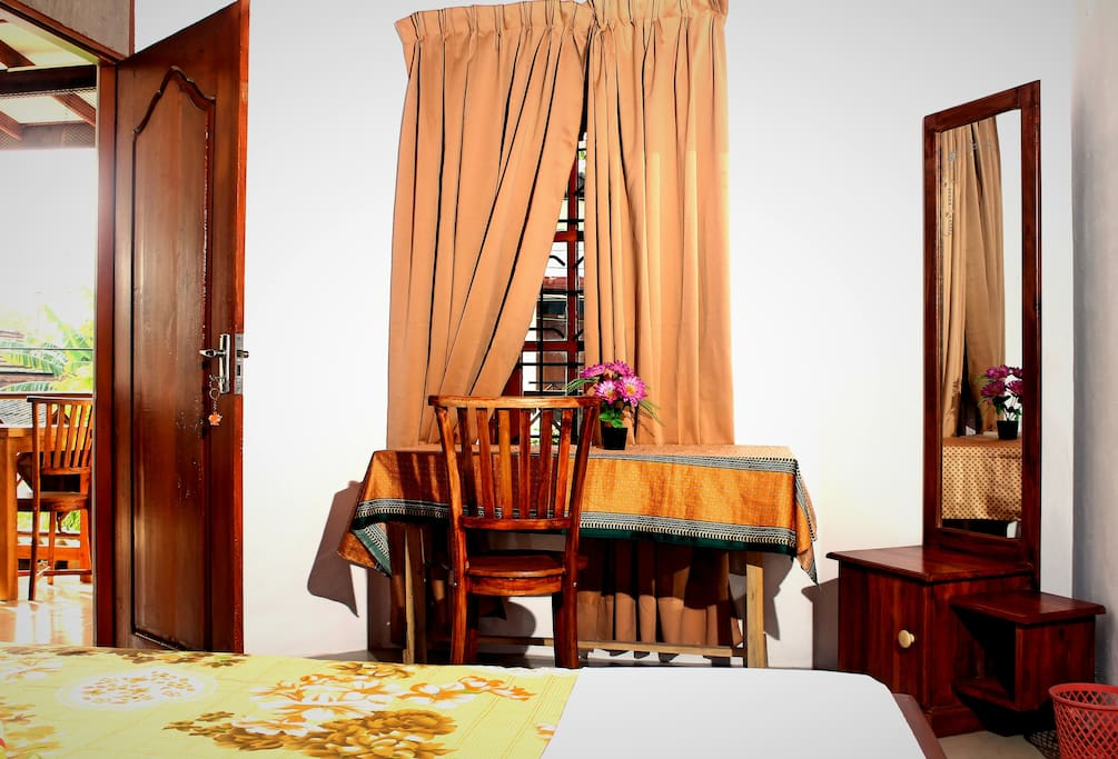 Outside view of the room, mirror and the private table.