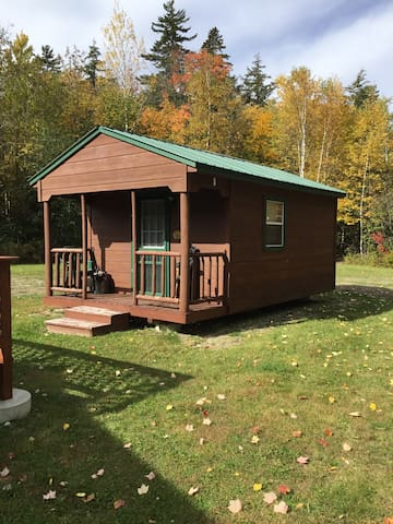 The bunkhouse with bunk bed, full bed, couch, and mini fridge