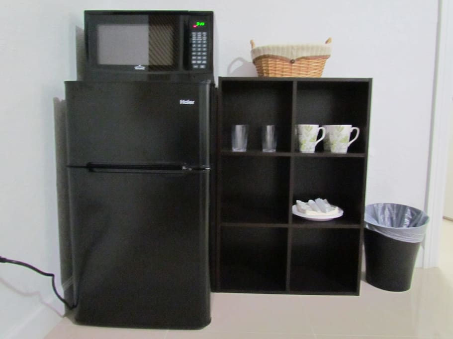 Mini-fridge and microwave. Silverware. Snacks.