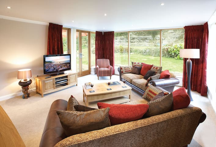 Ground floor:  Sitting room with TV and Sky HD, this room also leads on to the rear sun terrace
