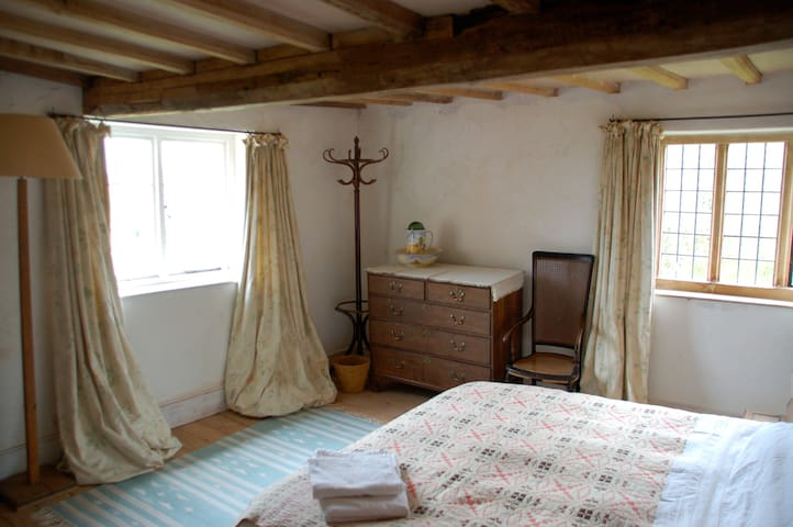 double room with shower, big bed and great views.