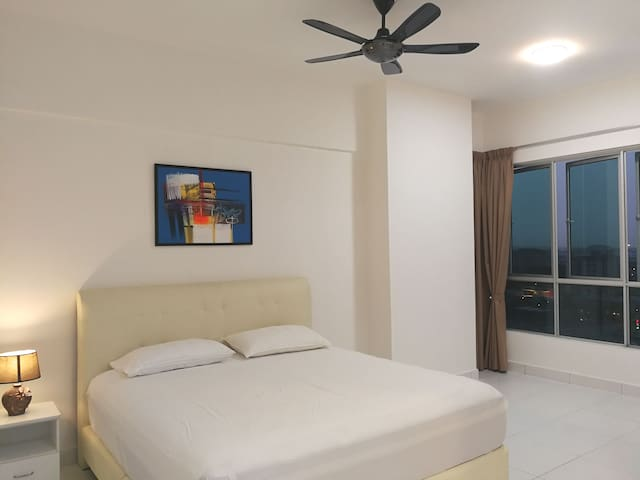 Master bedroom with king size bed overlooking the Penang bridge