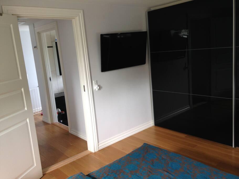 ... cupboard and TV (Apple-TV)