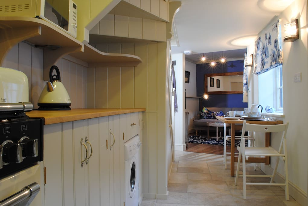 Custom built wooden kitchen, past the dining space at the foot of the stairs into the cosy sitting room