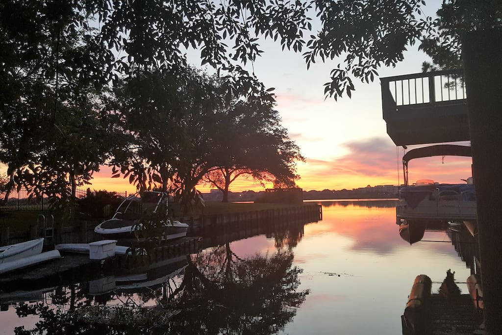 Sunrise from the 12 x 80 foot backyard dock on the water.