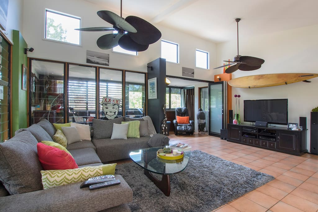Large open plan living. Huge ceiling fans and front louvers capture the Noosa breeze and keep it cool in summer.