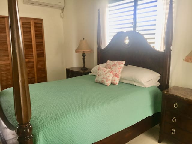 Unit 5 master bedroom with queen bed, en suite bathroom, huge walk in closet, dresser and nightstands, small office with desk and chair, private sitting area that opens unto private balcony via sliding glass door. Stunning sunrise and ocean view