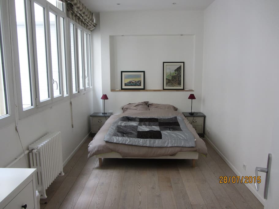 Large bedroom with a queen size bed
