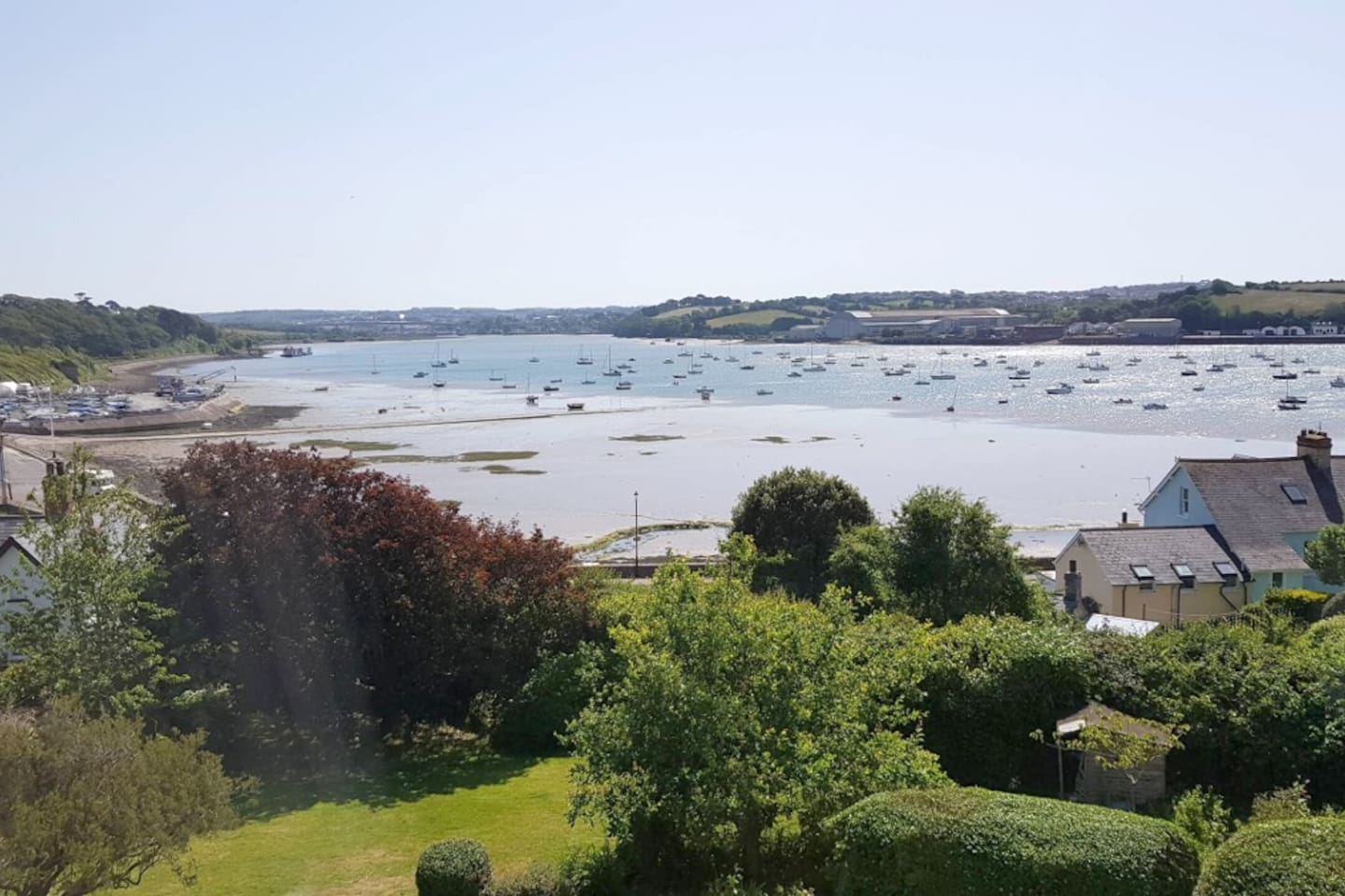 View from the sitting room towards the water, with the tide half out