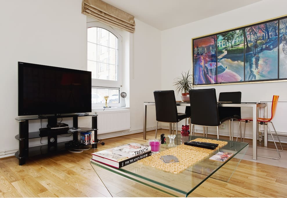 Living and dining area with cable TV including sports and Netflix.