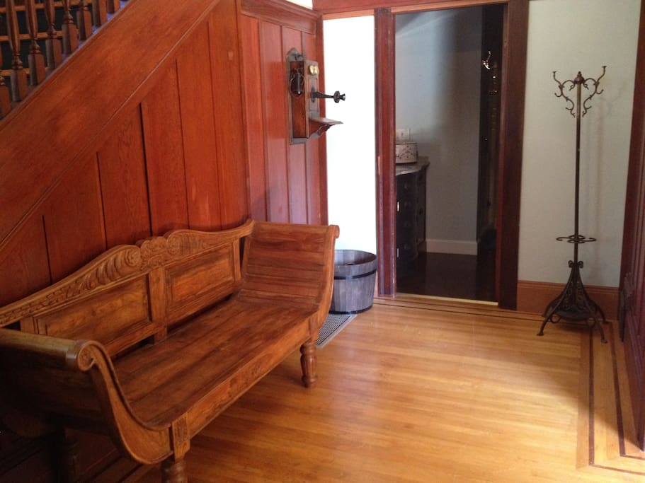 Just inside, the entry foyer offers a warm welcome and a place to sit & take off your shoes.