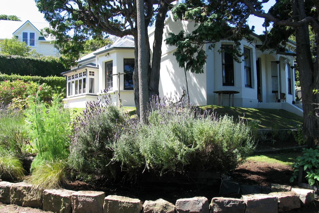 The 1880s villa is about eight minutes from the city centre and is set in a peaceful, private garden overlooking the Otago harbour and peninsula.