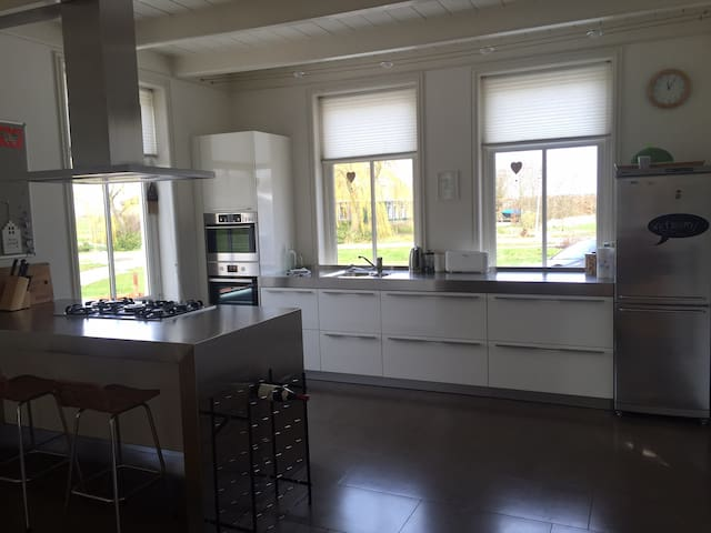 Modern kitchen with double baking oven, magnetron and cooking stove.
