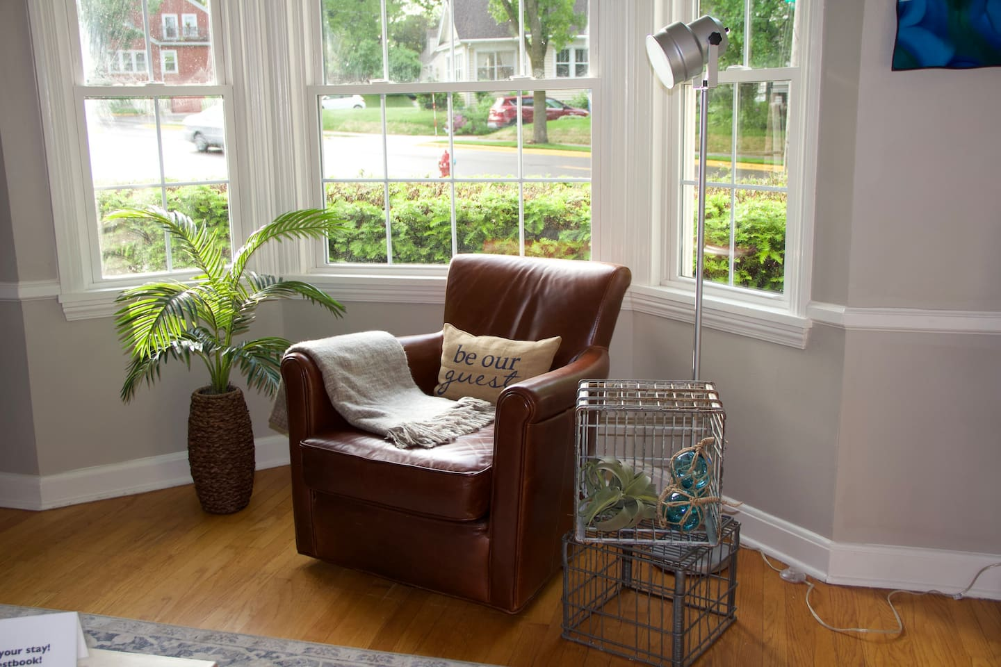 Be Our Guest!  This leather swivel chair is a great spot to catch the morning sun.