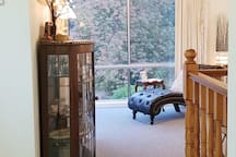 Relax on the chaise lounge overlooking the valley