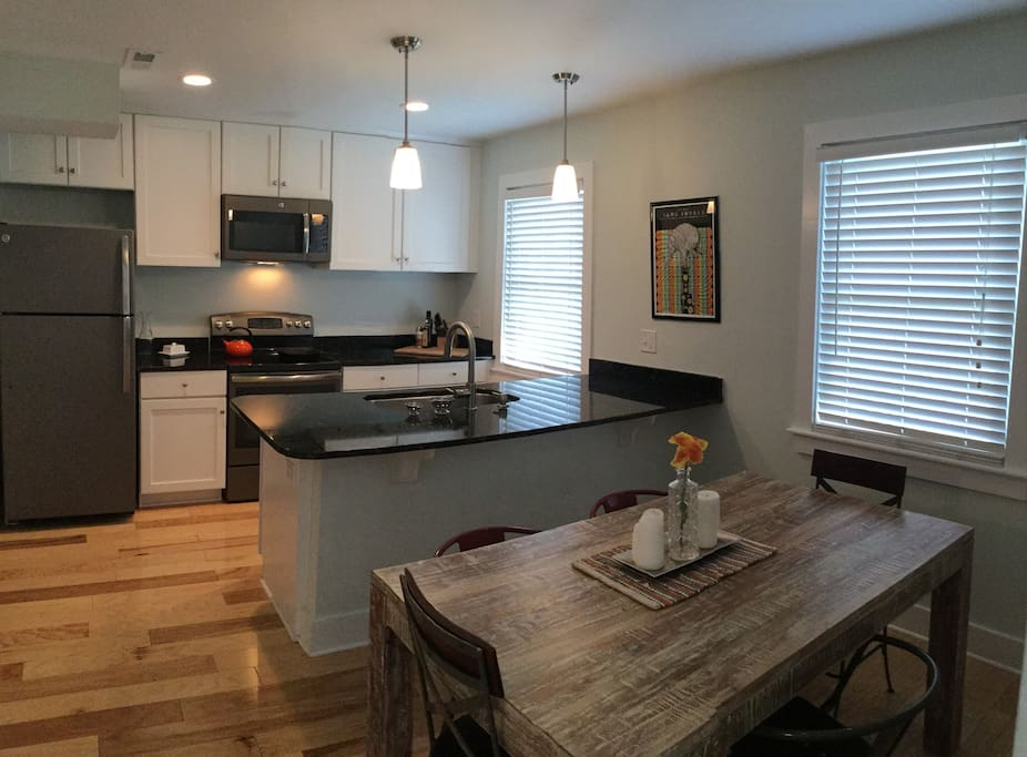 Newly renovated kitchen with granite counter tops. Lots of space for cooking