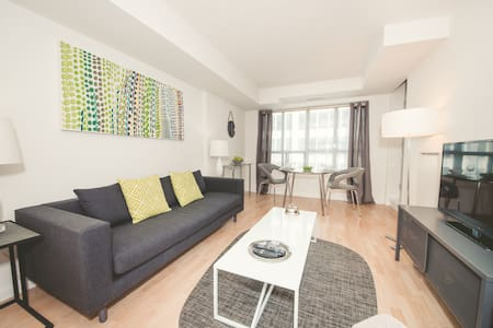 Prime downtown, subway just across the street, in the heart of the entertainment & financial districts. Condo with modern décor, 2 beds and 1 full bath, sleeps 3. Discover all that our city has to offer from your door! Minimum stay is 30 days.