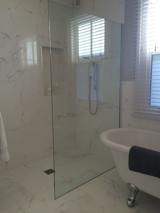 Walk-in power shower, fluffy White Company towels