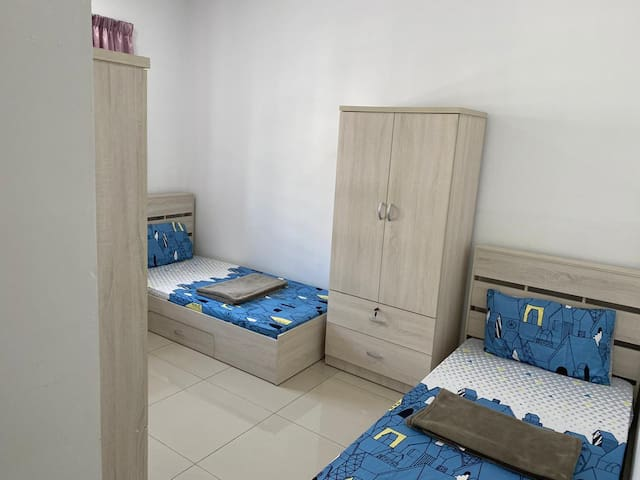 Another 3 bedrooms with 2 single beds.