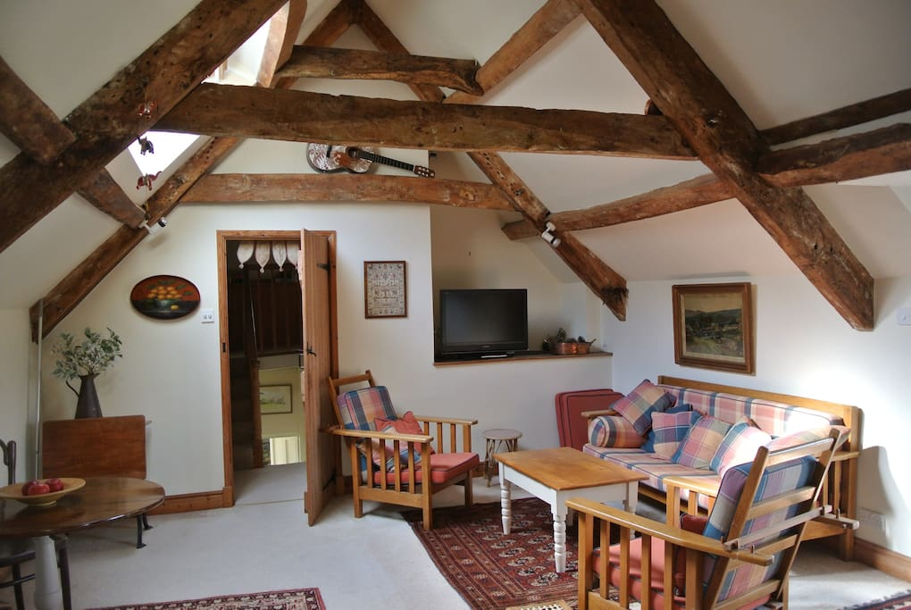 Sitting room with old rafters
