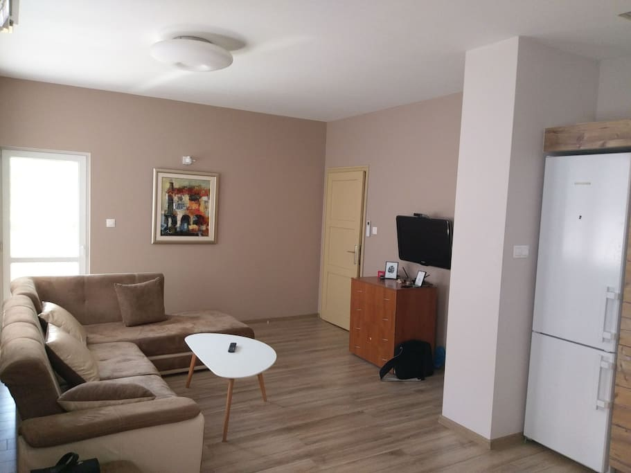 The livingroom is connected with the kitchen in a spacious and comfortable place for you.   Here is the additional double bed/sofa that we cover with memory foam top mattress. We also have one foldable bed (with top mattress of memory foam also), that is surprisingly comfortable for extra person and for short trips.